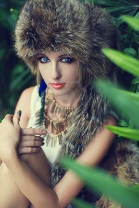 15833340-lady-in-a-fur-hat-in-the-jungle-fashion-portrait