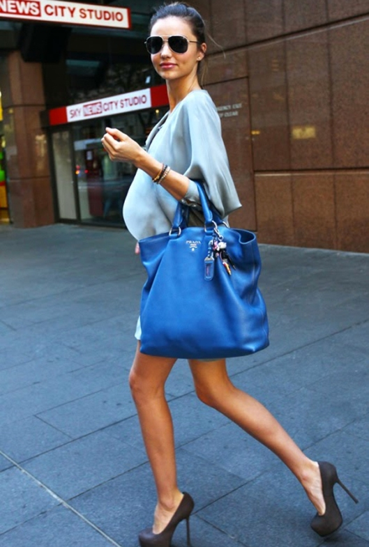 miranda kerr-blue prada bag- baby blue satin silk dress- grey pumps